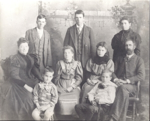 Frederick A. Lyon (sitting, right), Mary Elizabeth Lyon (sitting, left), and their seven children, Forest Grove, MT, 1897. (Author collection)