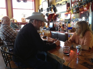 Doing research... The Bank, a bar in Wilsall's former bank building. Wilsall, MT, 2013 (Author photo)